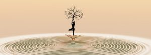 woman holding tree on water